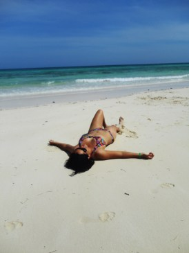 Lying on an isolated beach at the Bahamas. My reward for getting off the tourist infested resort!