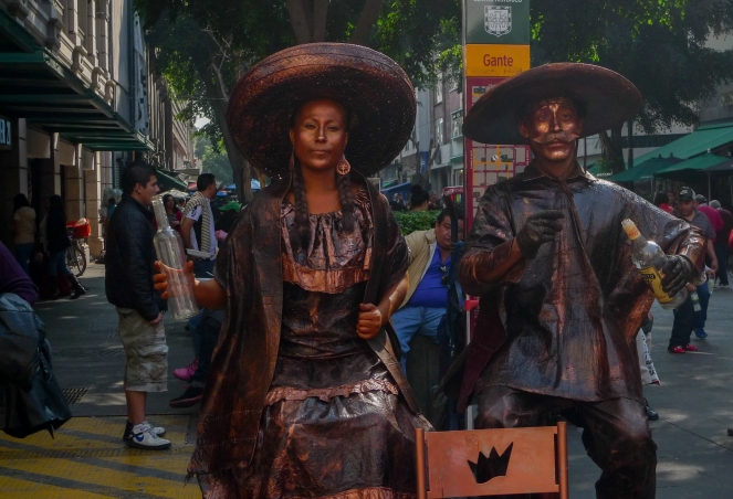 People posing as statues